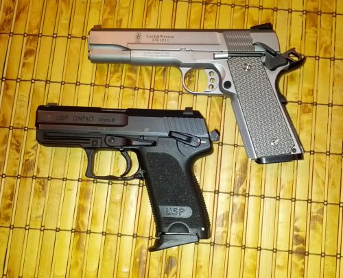 1911 with soft safety (top and H&K USP with hard safety (bottom).