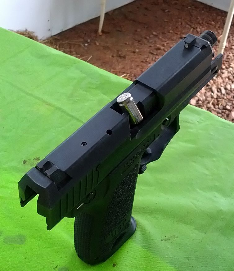 H&K USP Compact with stove piped defensive round